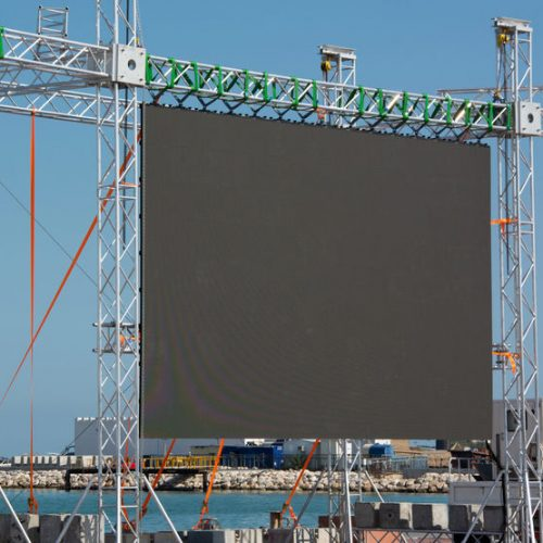 Big empty open-air black LED screen for public music event, copy space