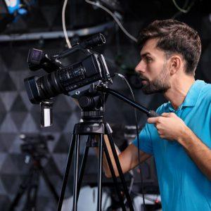 Professional video camera operator working in studio